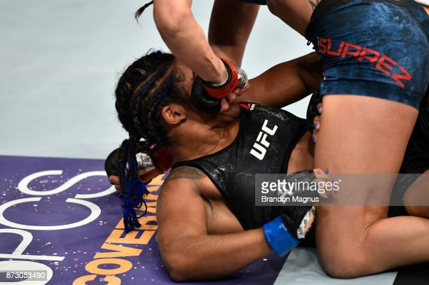 Tatiana Suarez punches Viviane Pereira of Brazil in their women's strawweight bout during the UFC Fight Night event inside the Ted Constant...