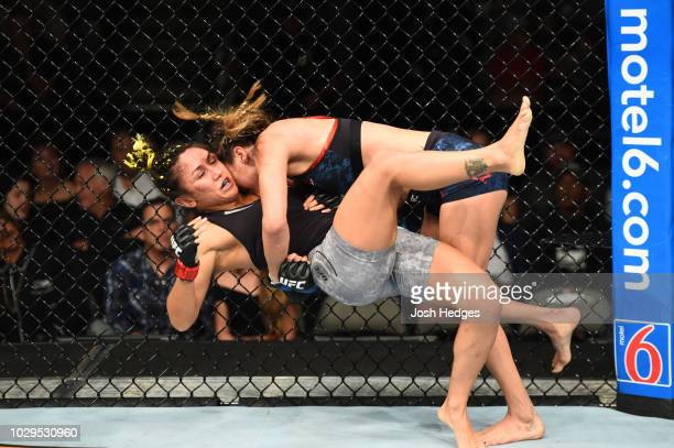 Tatiana Suarez takes down Carla Esparza in their women's strawweight fight during the UFC 228 event at American Airlines Center on September 8 2018...