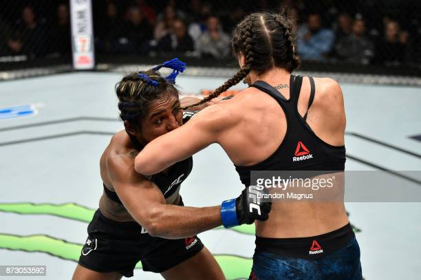 Tatiana Suarez throws an elbow to the face of Viviane Pereira of Brazil in their women's strawweight bout during the UFC Fight Night event inside the...