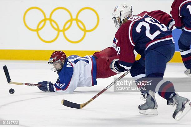 Tatiana Tsareva of Russia is up ended by Katie King of the USA during their Womens exhibition game in preparation for the 2002 Winter Olympics 07...