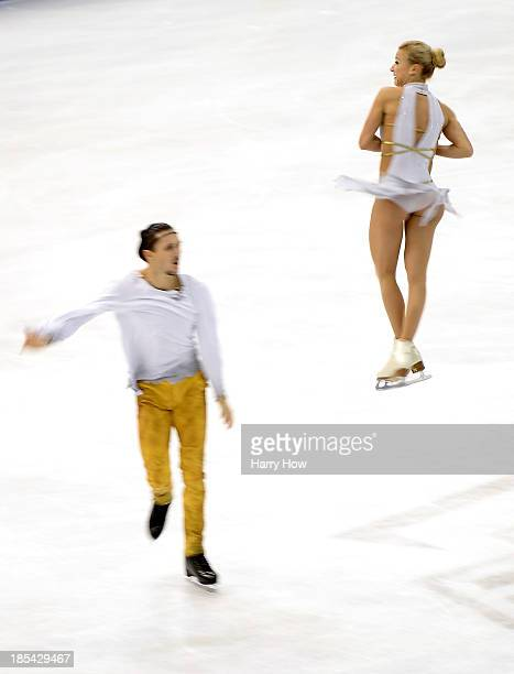 Tatiana Volosozhar and Maxim Trankov compete to a gold medal during the pairs free at Skate America 2013 at the Joe Louis Arena on October 20 2013 in...