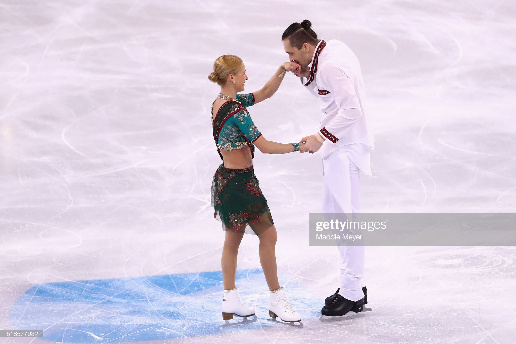 https://media.gettyimages.com/photos/tatiana-volosozhar-and-maxim-trankov-of-russia-celebrate-after-their-picture-id518577932?s=2048x2048