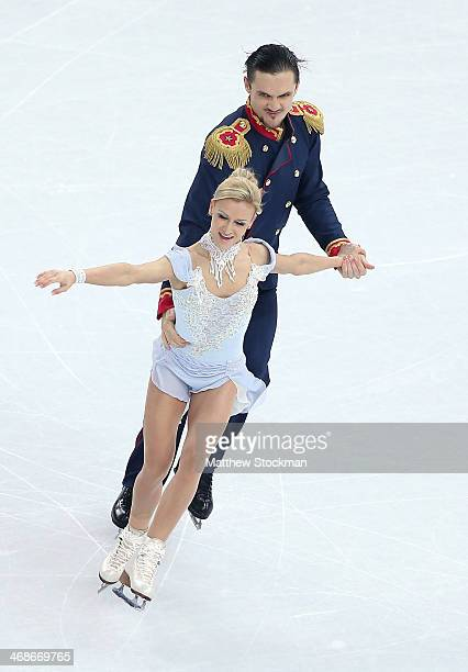 Tatiana Volosozhar and Maxim Trankov of Russia compete during the Figure Skating Pairs Short Program on day four of the Sochi 2014 Winter Olympics at...