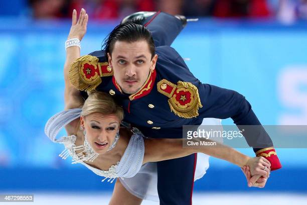 Tatiana Volosozhar and Maxim Trankov of Russia compete in the Figure Skating Pairs Short Program during the Sochi 2014 Winter Olympics at Iceberg...