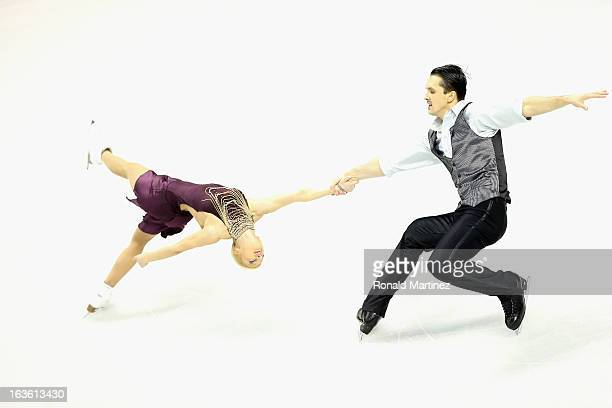Tatiana Volosozhar and Maxim Trankov of Russia compete in the Pairs Short Program during the 2013 ISU World Figure Skating Championships at Budweiser...