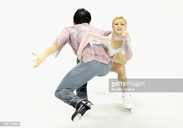 Tatiana Volosozhar and Maxim Trankov of Russia compete in the Pairs Free Skating during the 2013 ISU World Figure Skating Championships at Budweiser...