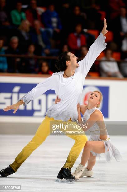 Tatiana Volosozhar and Maxim Trankov of Russia compete in the Pair's Free Skating competition during day two of the ISU Nebelhorn Trophy at...
