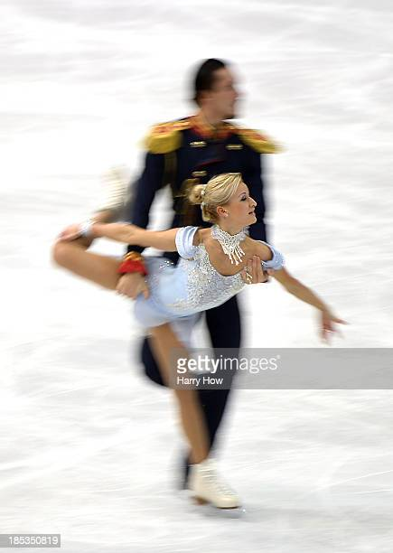 Tatiana Volosozhar and Maxim Trankov of Russia compete in the pairs short program at Skate America 2013 at Joe Louis Arena on October 19 2013 in...
