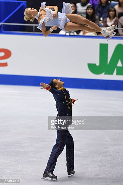 Tatiana Volosozhar and Maxim Trankov of Russia compete in the pairs short program during day one of ISU Grand Prix of Figure Skating 2013/2014 NHK...