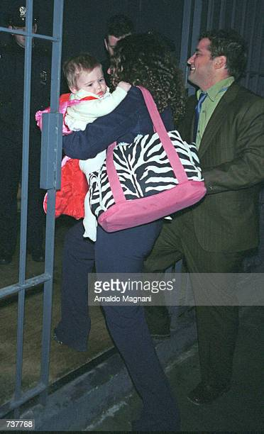 Tatiana Von Furstenberg carrying baby daughter Antonia Steinberg and her husband Russell Steinberg arrive at the party to celebrate the wedding of...