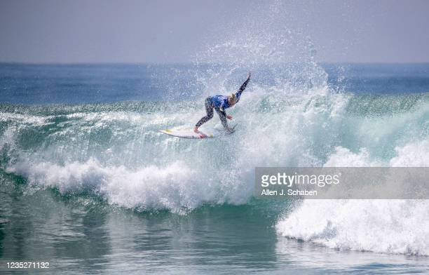Tatiana Weston-Webb, of Brazil, floats down a big wave while competing against Five-time WSL world champion and olympic gold medalist Carissa Moore,...