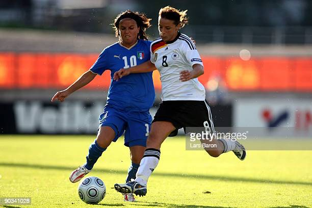 Tatiana Zorri of Italy challenges Inka Grings of Germany during the UEFA Women's Euro 2009 quarter final match between Germany and Italy at Lahti...