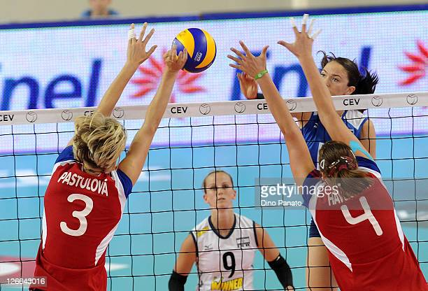 Tatjan Frage Gerber of Israel drops a shot against Kristina Pastulova and Aneta Havlickova of Czech Republic during the Women's Volleyball European...