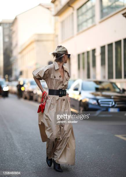 Tatjana Catic seen wearing a beige dress before Tods during Milan Fashion Week Fall/Winter 2020-2021 on February 21, 2020 in Milan, Italy.