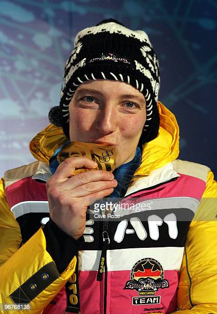 Tatjana Huefner of Germany celebrates winning the gold medal during the medal ceremony for the Women's Luge Singles on day 5 of the Vancouver 2010...