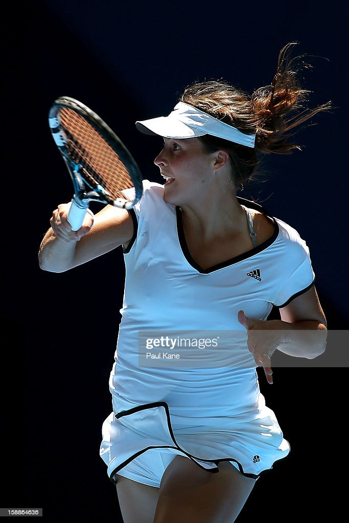 Tatjana Malek of Germany plays a backhand to Francesca Schiavone of Italy in her singles match during day five of the Hopman Cup at Perth Arena on January 2, 2013 in Perth, Australia.