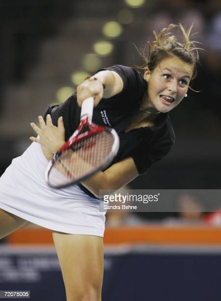 Tatjana Malek of Germany serves to Anna-Lena Groenefeld of Germany during the Porsche Tennis Grand Prix at the Porsche Arena on October 3, 2006 in...