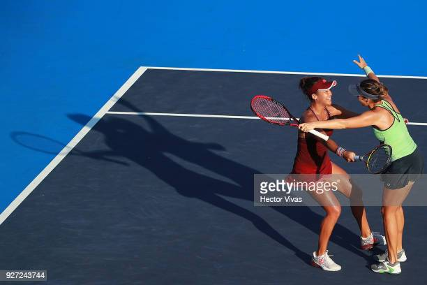 Tatjana Maria of Germany and Heather Watson of Great Britain celebrate during the doubles Championship match between Tatjana Maria of Germany with...