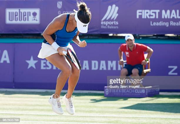 Tatjana Maria of Germany celebrates a match point against Anastasija Sevastova of Latvia in the final during day seventh of the Mallorca Open at...