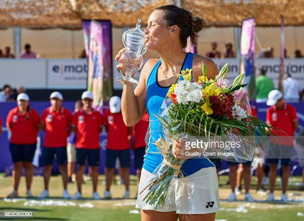 Tatjana Maria of Germany kisses the trophy in celebration after her win over Anastasija Sevastova of Latvia in the final during day seventh of the...