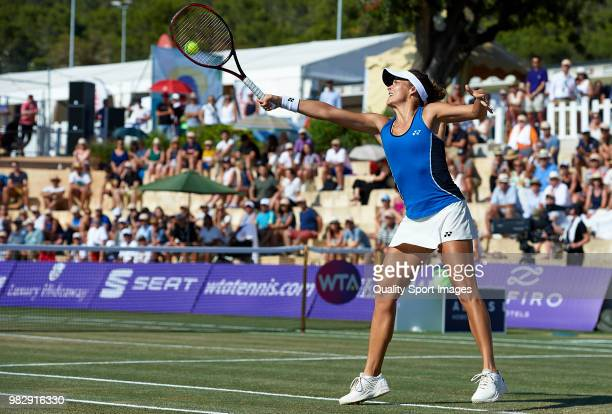 Tatjana Maria of Germany returns a shot against Anastasija Sevastova of Latvia in the final during day seventh of the Mallorca Open at Country Club...