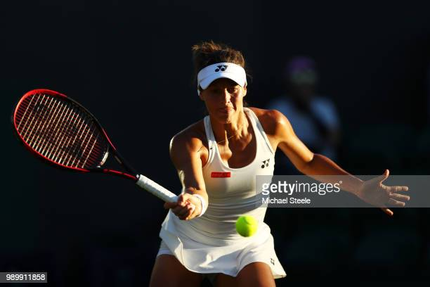Tatjana Maria of Germany returns against Elina Svitolina of Ukraine during their Ladies' Singles first round match on day one of the Wimbledon Lawn...