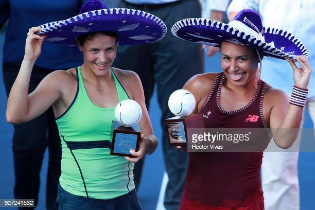 Tatjana Maria of Germany with Heather Watson of Great Britain celebrate with the champions trophy after the Championship match between Tatjana Maria...
