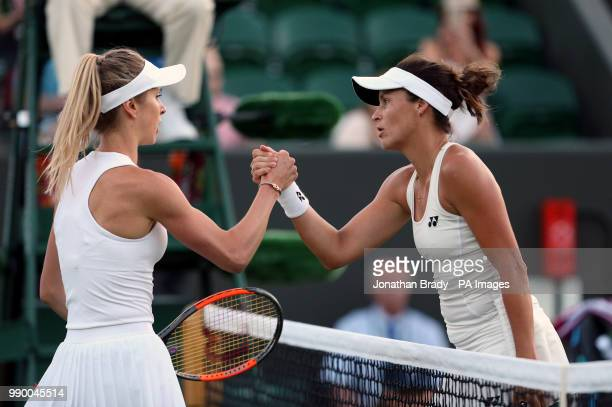 Tatjana Maria shakes hands with Elina Svitolina after beating her on day One of the Wimbledon Championships at the All England Lawn Tennis and...