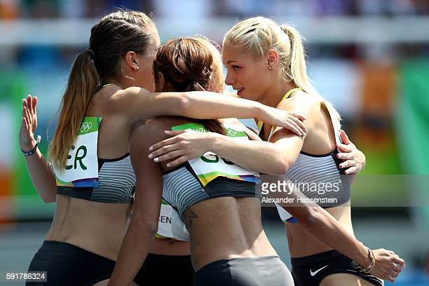 Tatjana Pinto Lisa Mayer Gina Luckenkemper and Rebekka Haase of Germany react during round one of the Women's 4 x 100m Relay on Day 13 of the Rio...