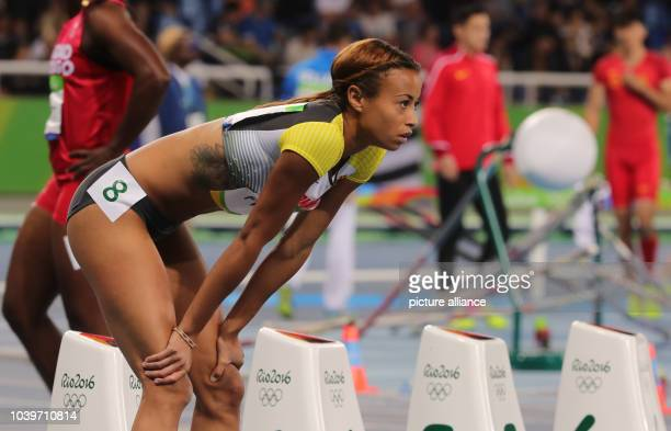 Tatjana Pinto of Germany competes in Women's 100m Semifinals of the Athletic Track and Field events during the Rio 2016 Olympic Games at Olympic...