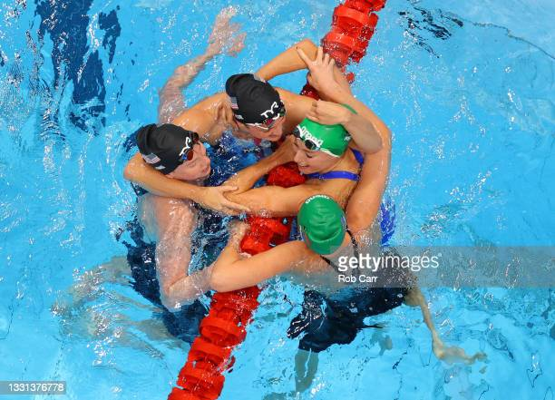Tatjana Schoenmaker of Team South Africa is congratulated by Lilly King of Team United States, Annie Lazor of Team United States and Kaylene Corbett...