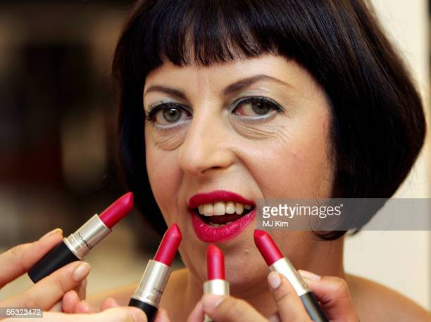 """Tatler Fashion Director Isabella Blow poses for photographers, to launch her limited edition MAC Cosmetics lipstick """"Blow"""" at Harvey Nichols on..."""