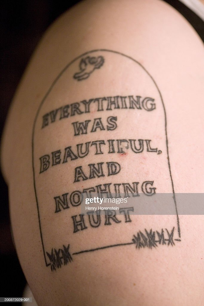 Tatoo of headstone on woman's arm, side view, close-up : Stock Photo