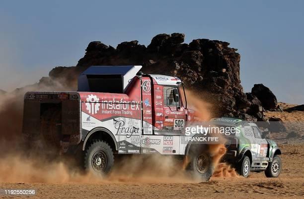 Tatra's Czech truck driver Ales Loprais and Czech co-driver Petr Pokora and Emirati co-driver Khalid Alkendi ride preceded by Lithuanian driver...