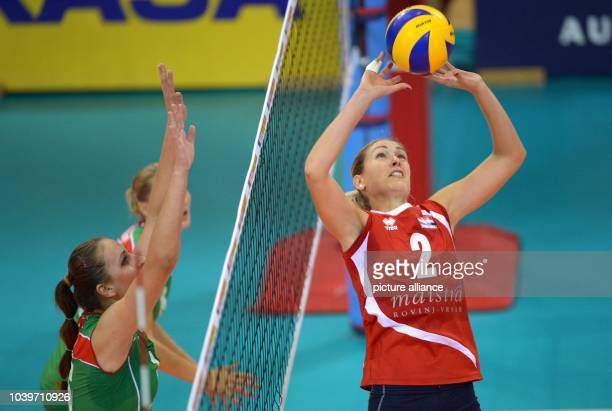 Tatsiana Markevich of Belarus in action against Ana Grbac of Croatia during their women's CEV Volleyball European Championship Group C match between...