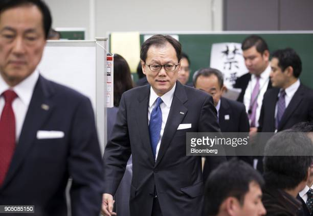 Tatsufumi Sakai president and chief executive officer of Mizuho Securities Co center and Yasuhiro Sato president and chief executive officer of...