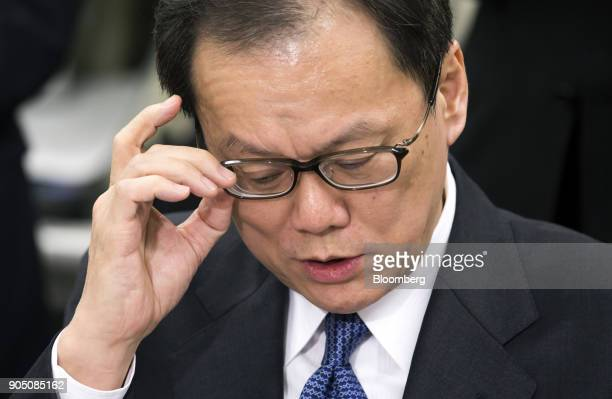 Tatsufumi Sakai president and chief executive officer of Mizuho Securities Co adjusts his glasses during a news conference in Tokyo Japan on Monday...