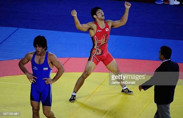 Tatsuhir Yonemitsu of Japan celebrates winning Gold against Kermani Taghavi of Iran in the Men's Freestyle 66kg class Final at Huagong Gymnasium...