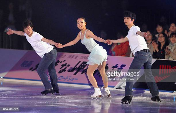 Tatsuki Machida Mao Asada and Yuzuru Hanyu perform during the Stars On Ice at Yoyogi Gymnasium on April 11 2014 in Tokyo Japan