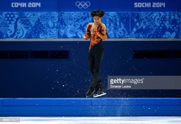 Tatsuki Machida of Japan competes during the Figure Skating Men's Free Skating on day seven of the Sochi 2014 Winter Olympics at Iceberg Skating...
