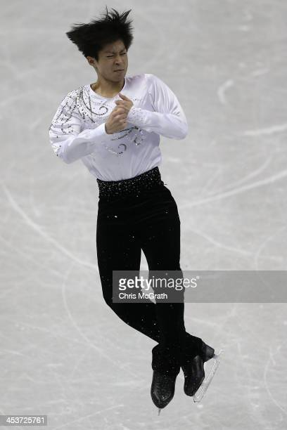 Tatsuki Machida of Japan competes in the Men's Short Program during day one of the ISU Grand Prix of Figure Skating Final 2013/2014 at Marine Messe...