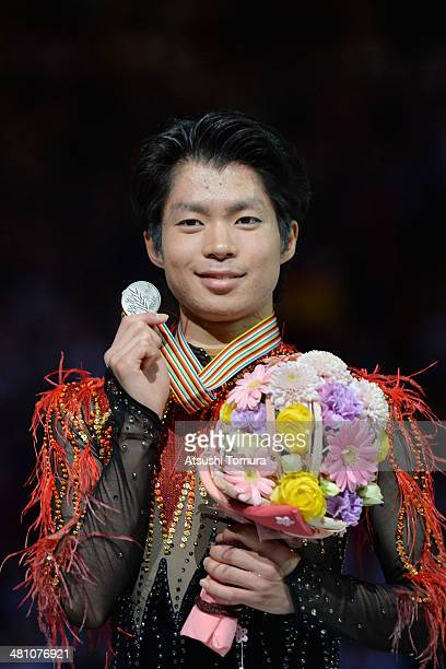 Tatsuki Machida of Japan poses with silver medal in the victory ceremony during ISU World Figure Skating Championships at Saitama Super Arena on...