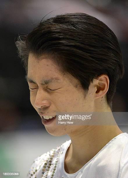 Tatsuki Machida of Japan reacts after his skate during the men's short program at Skate America 2013 at Joe Louis Arena on October 18 2013 in Detroit...