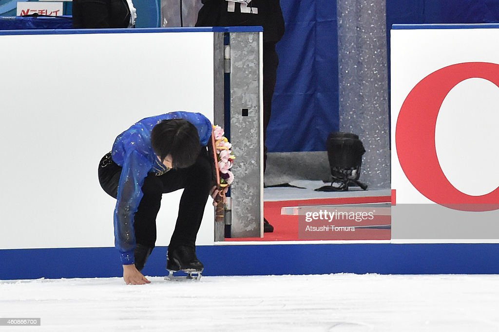 Tatsuki Machida of Japan touches ice as he exits the ice rink after announce his retirement at the end of the 83rd All Japan Figure Skating Championships at the Big Hat on December 28, 2014 in Nagano, Japan.