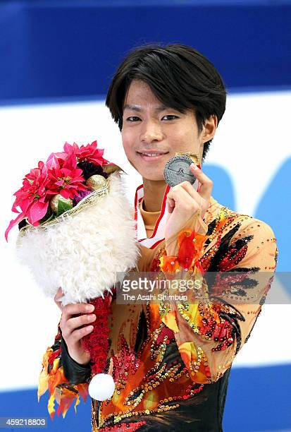 Tatsuki Machida poses for photographs after winning silver in the Men's Singles during the 82nd All Japan Figure Skating Championships at Saitama...