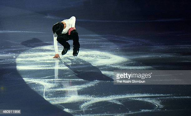 Tatsuki Machida touches ice after his performance during the All Japan Medalist On Ice 2014 at the Big Hat on December 29 2014 in Nagano Japan