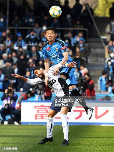 Tatsuki Nara of Kawasaki Frontale and Diego Oliveira of FC Tokyo compete for the ball during the JLeague J1 match between Kawasaki Frontale and FC...