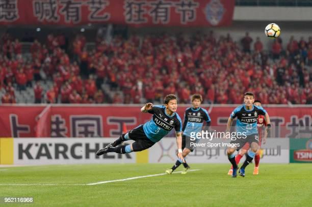 Tatsuki Nara of Kawasaki Frontale heads the ball during the AFC Champions League 2018 Group Stage F Match Day 5 between Shanghai SIPG and Kawasaki...