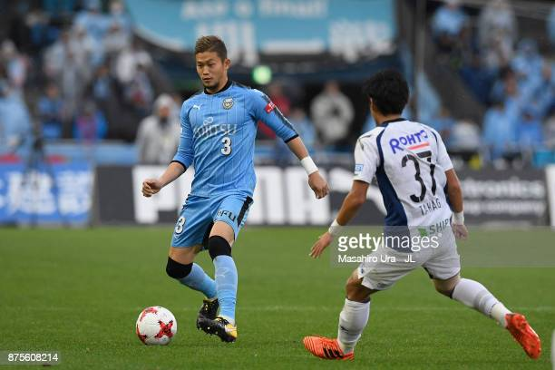 Tatsuki Nara of Kawasaki Frontale takes on Akito Takagi of Gamba Osaka during the JLeague J1 match between Kawasaki Frontale and Gamba Osaka at...
