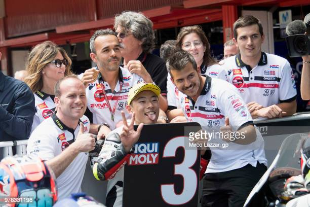 Tatsuki Suzuki of Italy and Sic 58 Squadra Corse celebrates the Moto3 third place with team at the end of the qualifying practice during the MotoGp...